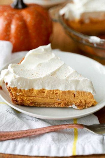 A rich and creamy baked pumpkin cheesecake with warm fall spices and a creamy whipped topping. This luscious dessert recipe takes just 5 minutes of prep time and gives perfect results every time!