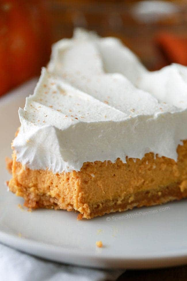 A Rich And Creamy Baked Pumpkin Cheesecake With Warm Fall Es Whipped Topping No Bake