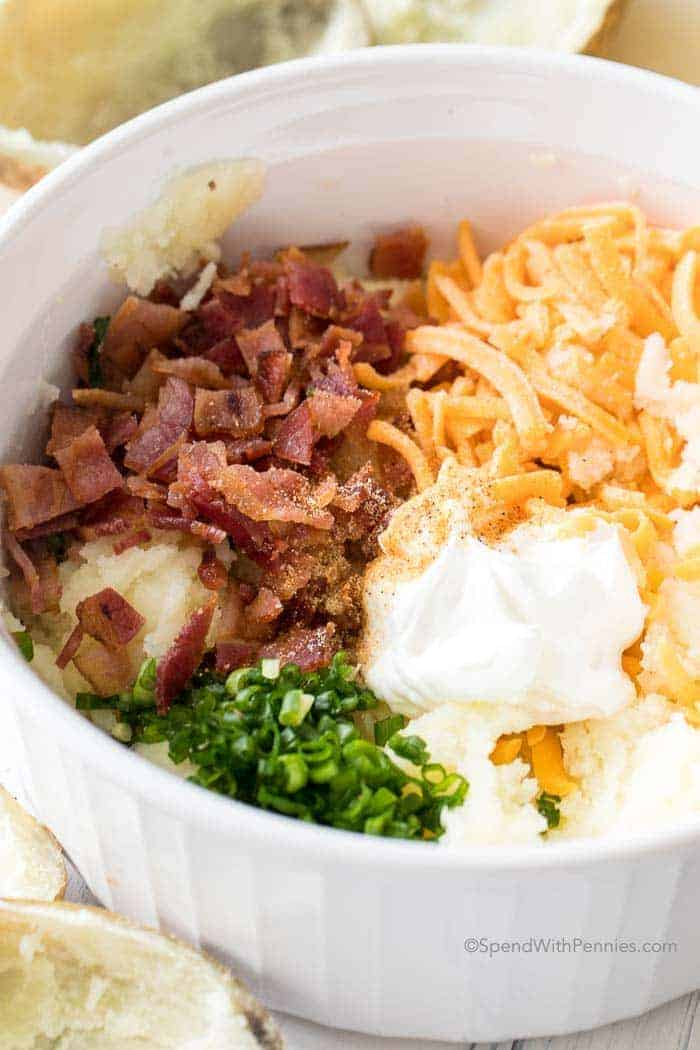 How to make twice baked potatoes - bowl of potatoes, bacon, cheese and chives
