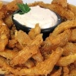 a plate blooming onion bites with dip