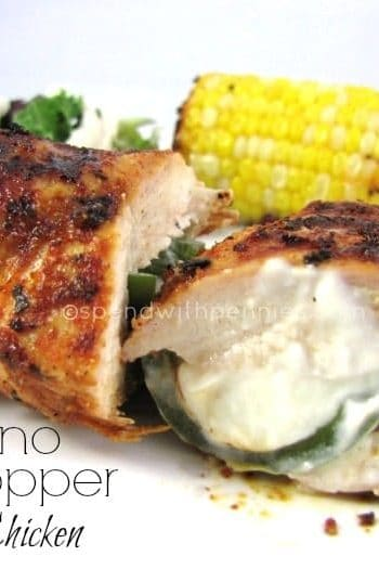 jalapeno popper stuffed chicken breasts with a cob of corn on the side