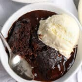 baked chocolate pudding cake in a bowl with a spoon