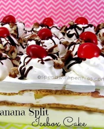 banana split ice box cake topped with whipped cream and cherries