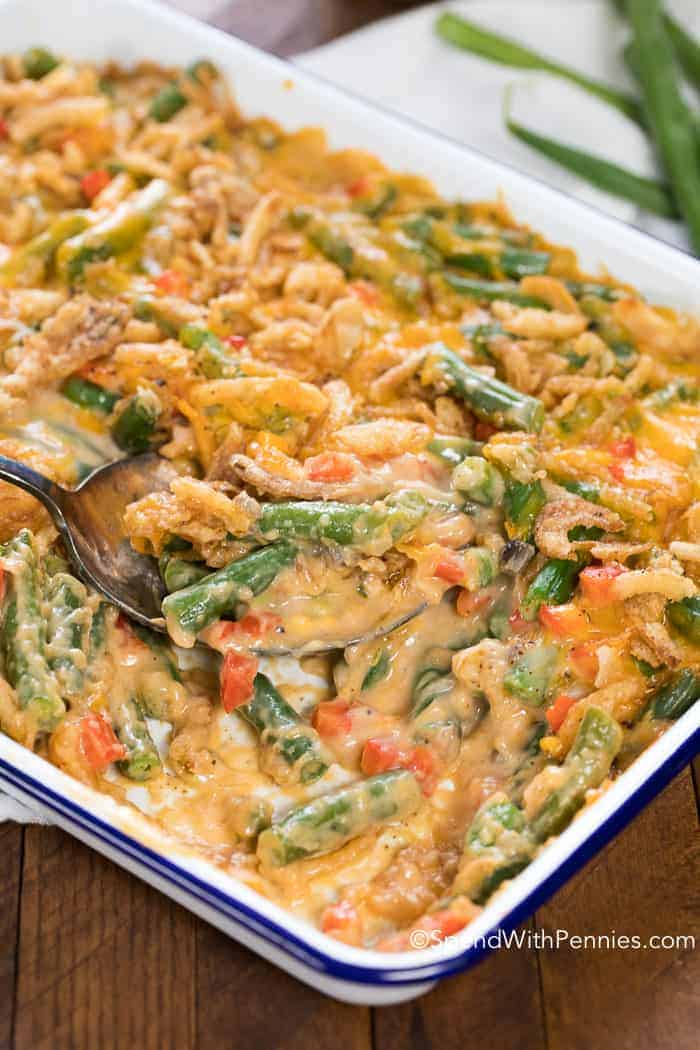 Green Bean Casserole is a classic side dish, great for special occasions like Thanksgiving or Christmas, yet still perfect any time of year! This recipe features fresh green beans cooked until tender crisp in a creamy mushroom sauce with fried onions and of course cheese. The perfect green bean casserole!