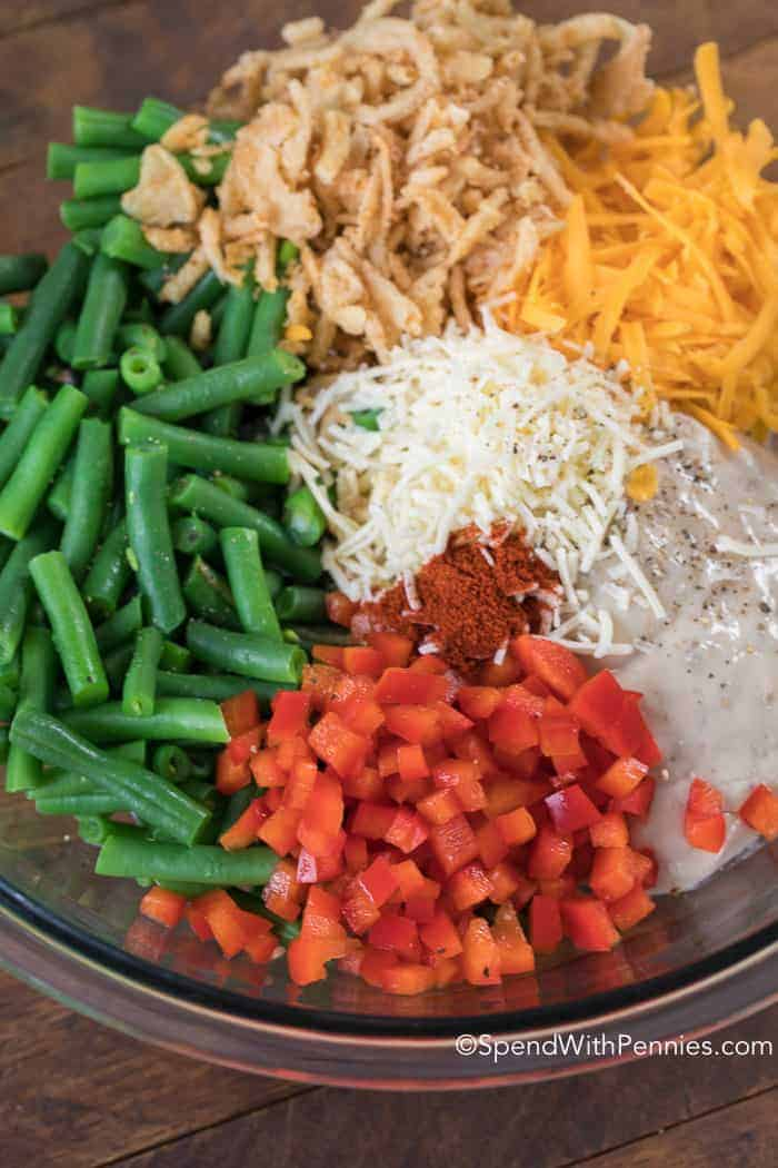 Green Bean Casserole is a classic side dish featuring fresh green beans cooked in a creamy mushroom sauce with fried onions and of course cheese. The perfect green bean casserole!