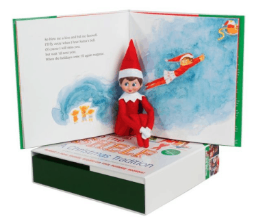 elf on the shelf with a book