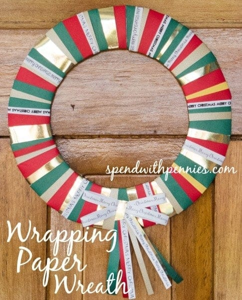 wrapping paper wreath hung on the door