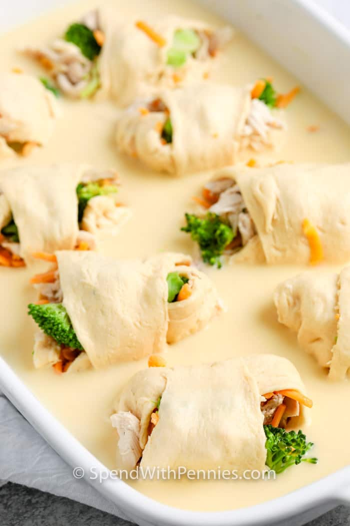 Chicken Roll Ups in a casserole dish and sauce uncooked