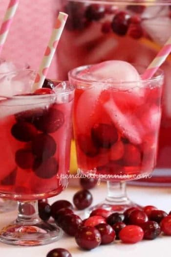 close up of glasses of celebration punch with cranberries on the table