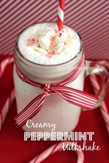 peppermint milkshake in a glass with ribbon and a straw