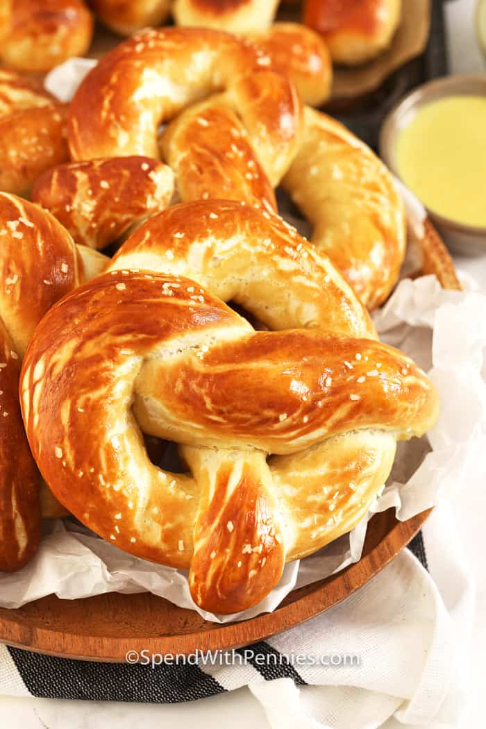 Baked soft pretzels in a basket with honey mustard dip