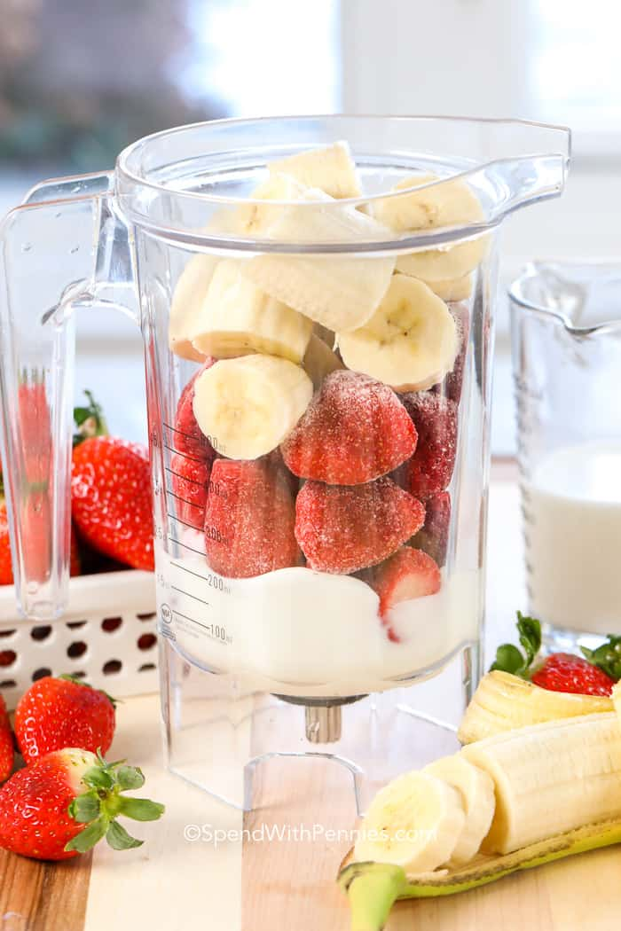 Strawberry Banana Smoothie ingredients in a blender