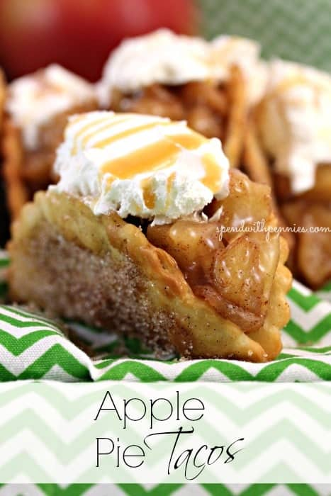 apple pie tacos topped with whipped cream and caramel