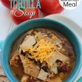 slow cooker chicken tortilla soup in blue bowl