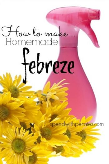 a pink spray bottle of homemade febreeze with flowers around it