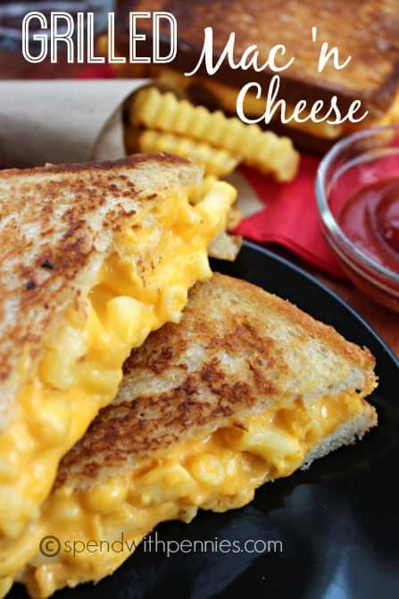 mac and cheese grilled sandwich on a plate with fries and ketchup