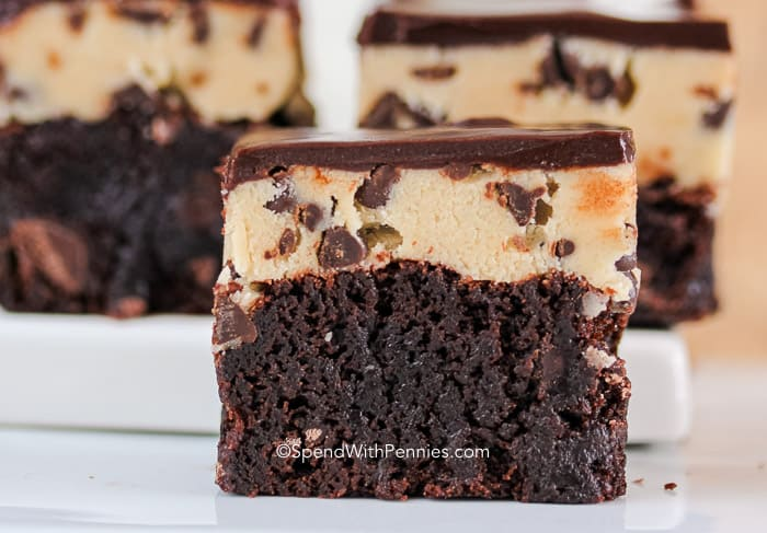 3 Brownies topped with chocolate chip cookie dough and chocolate ganache