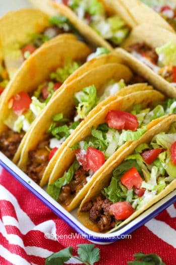 Ground Beef Tacos in a dish with cilantro on the side