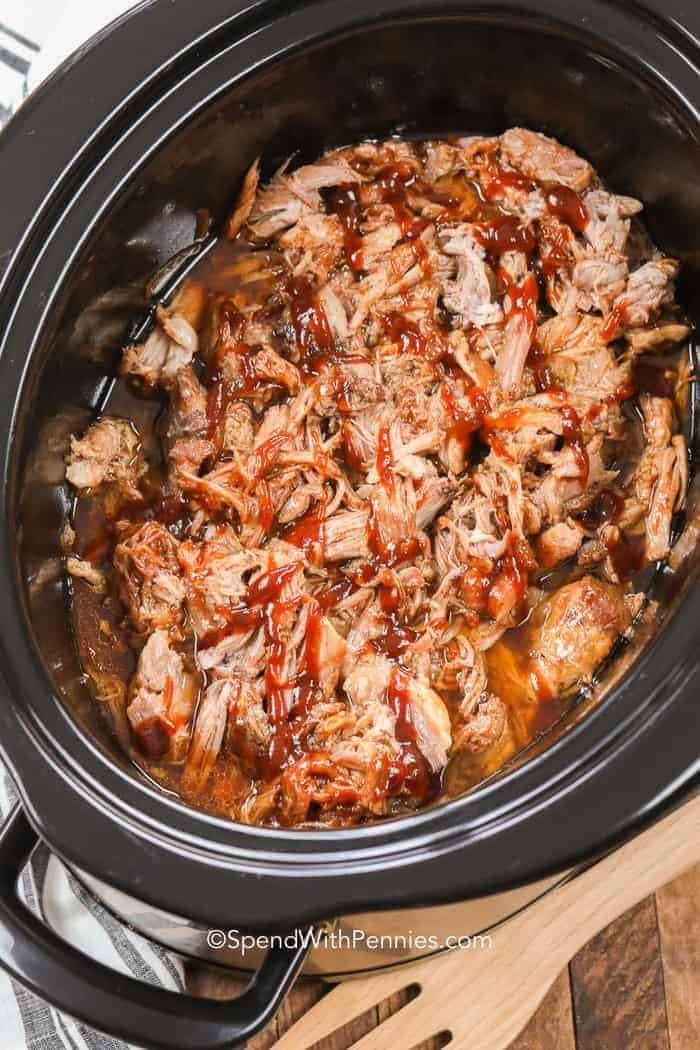 Overhead shot of pulled pork in a black slow cooker