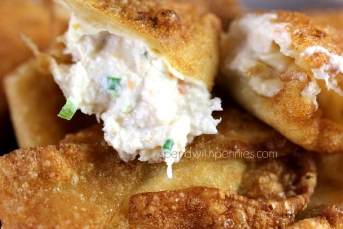 close up of Crab Rangoon recipe with crab, cream cheese and seasonings wrapped in a wonton wrapper and fried crispy