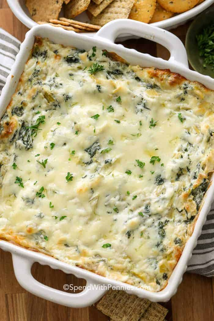 A dish of hot spinach artichoke dip ready for serving