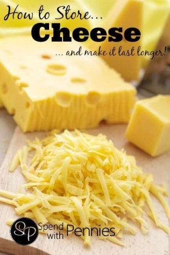 Cheese block and shredded cheese on a board