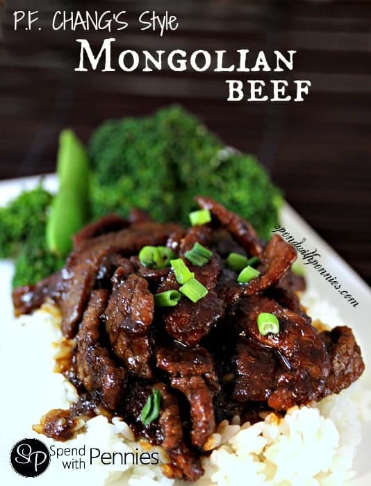 PF Changs style Mongolian beef on a white plate garnished with green onions