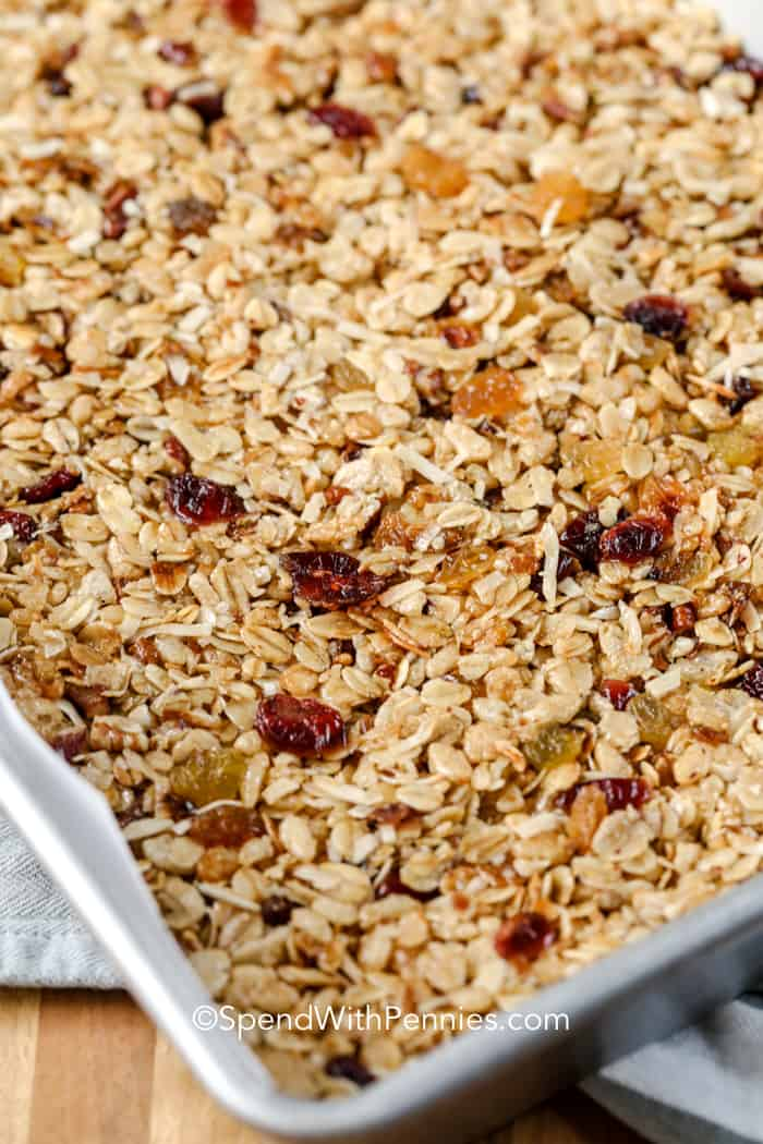 A baking pan with granola bar ingredients pressed into it.