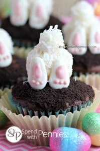 close up of bunny butt cupcakes with little feet and tails with decorative eggs