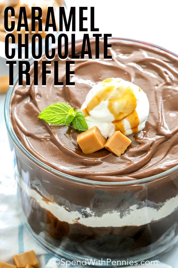 Caramel Chocolate Trifle with cream and caramel cubes on top with a title