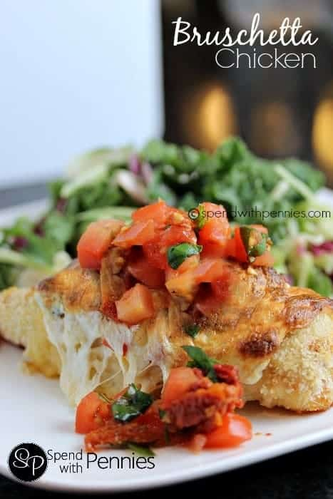 bruschetta chicken bake with Fresh tomatoes and basil on white plate