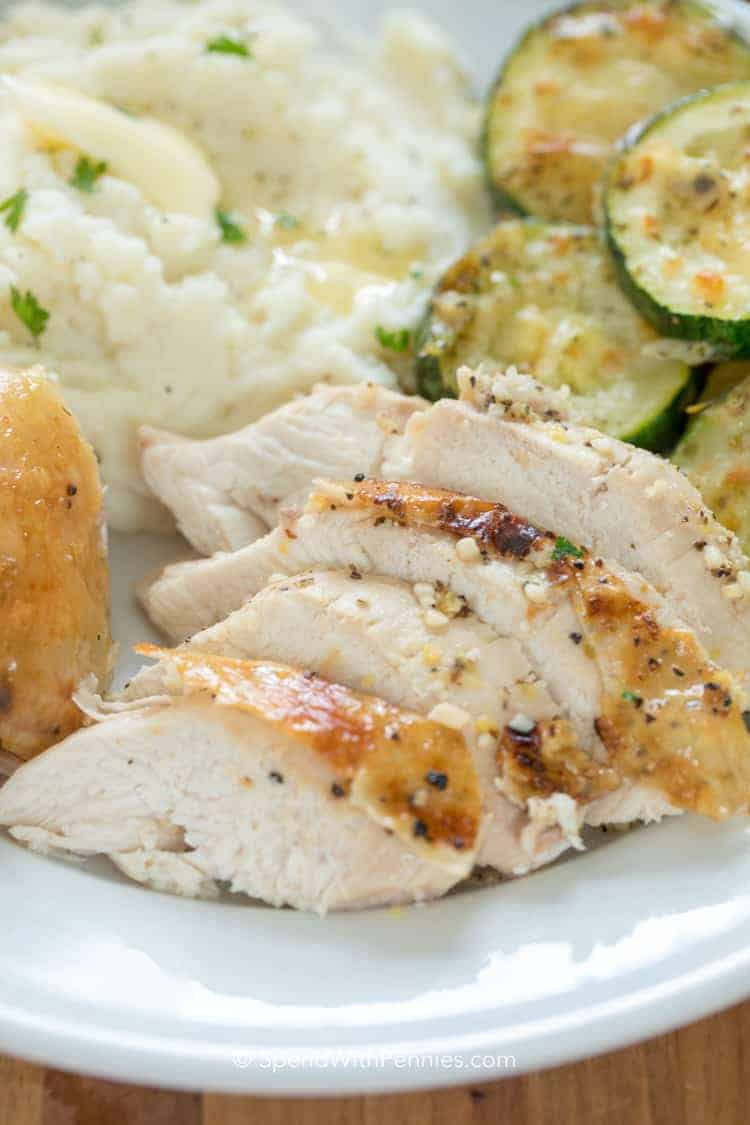 Lemon Roast Chicken on a plate with zucchini and potatoes