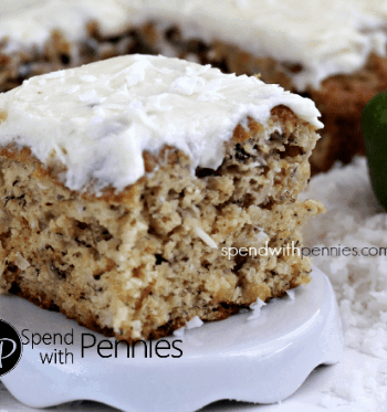 a slice of tropical banana snack cake with lime frosting on a little white plate