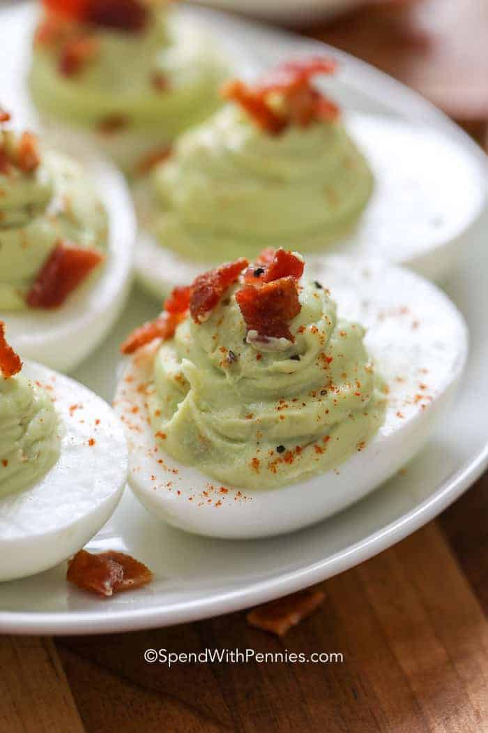 avocado deviled eggs with bacon on a plate ready to serve