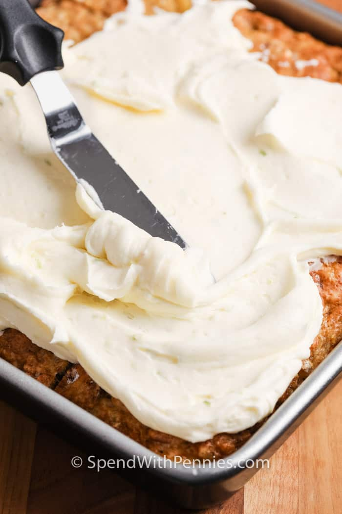Tropical Banana Snack Cake being iced with icing