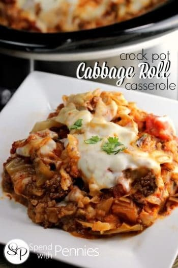 a serving of cheesy Cabbage Roll Casserole with the slow cooker in the background