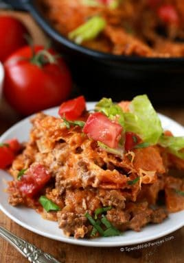 Layered Doritos Casserole is an easy family favorite recipe! Lean ground beef is seasoned with taco seasoning and salsa to create a delicious filling. Layers of Doritos create a delicious base for this casserole which is then topped with cheese and baked until brown and bubbly. We top it with our favorite taco inspired toppings!