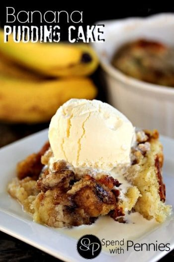 a serving of Banana Pudding Cake with ice cream on a white plate with bananas and a casserole dish in the background