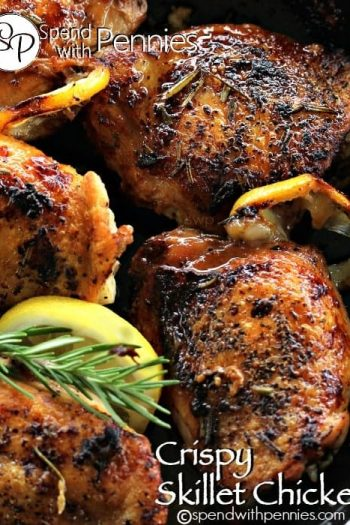 Crispy Skillet Chicken with crispy skin, roasted lemons and rosemary garnish