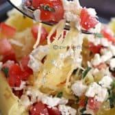 close up of Greek Spaghetti Squash with feta and tomatoes