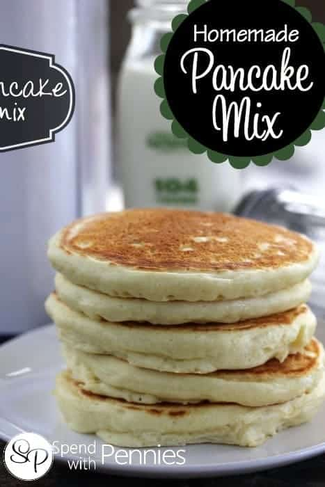 A stack of homemade pancakes with a container of homemade pancake mix.