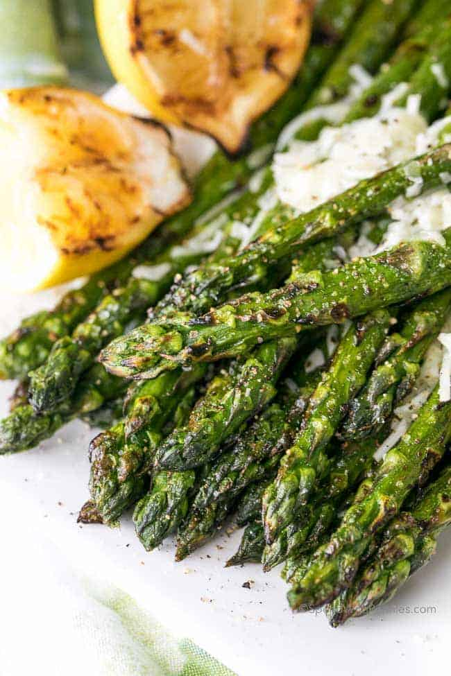 This is the BEST Grilled Asparagus we've ever had! Perfect along side any steak or barbecued chicken dish!  This easy recipe elevates a traditional grilled asparagus by adding a touch of parmesan cheese and a squeeze of grilled fresh lemon... easy enough for an everyday meal and amazing enough to wow your guests!