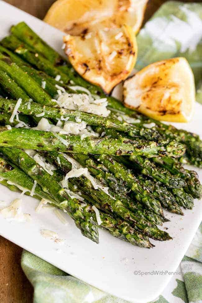 Grilled Asparagus with parmesan cheese on white plate