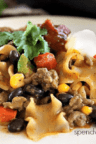 cheesy Mexican style casserole with noodles topped with cilantro