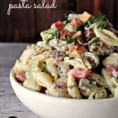 Chicken Club Pasta Salad in a bowl with dill