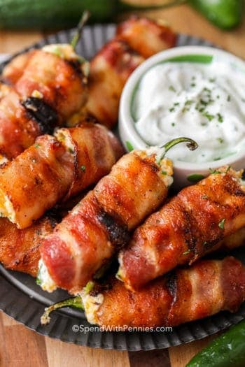 Grilled Bacon Jalapeno Poppers on a plate with dip