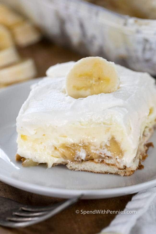 A slice of creamy banana pudding with layers of fresh bananas, vanilla pudding layer and freshly whipped cream makes the perfect potluck dish!