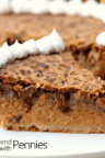 close up of Perfect Pumpkin Pecan Pie slice on plate