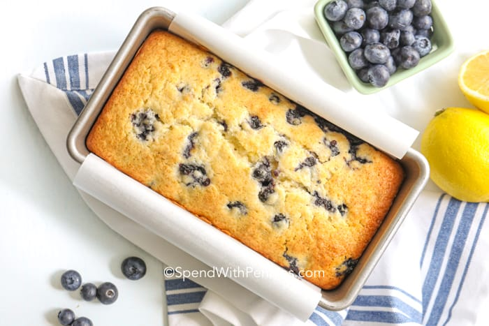 Overview of a baked lemon blueberry loaf in a loaf pan.