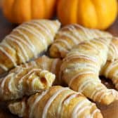 glazed Pumpkin Pie crescents with pumpkins in the background